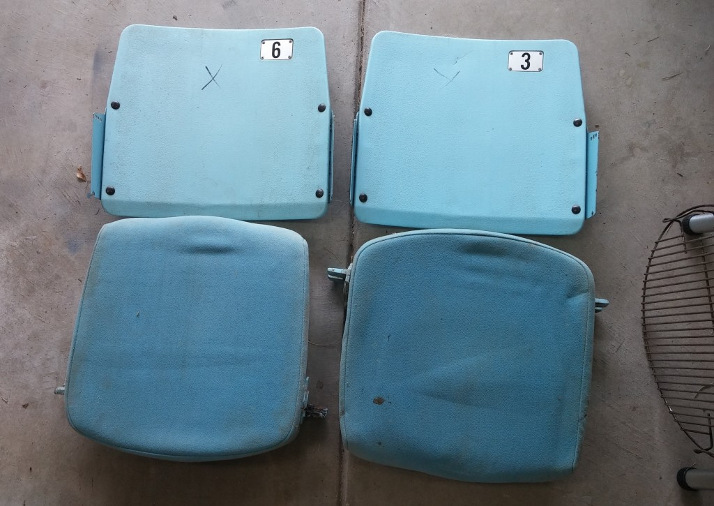 As is. Two seats from the Dean Dome as they came - backs and seats only. Nothing else (except 30 plus years of grime).